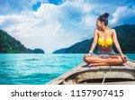 traveler asian woman in bikini... | Shutterstock . vector #1157907415