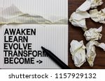 Small photo of Handwriting text writing Awaken Learn Evolve Transform Become . Concept meaning Inspiration Motivation Improve Marker over notebook crumpled papers ripped pages several tries mistakes.