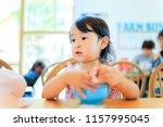diet and little girl | Shutterstock . vector #1157995045