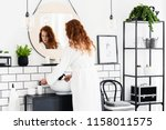 Young Woman Washing Hands In A...