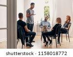 spanish man talking to... | Shutterstock . vector #1158018772