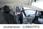 busy man in suit getting in car ... | Shutterstock . vector #1158037972