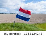 waving dutch flag in a typical... | Shutterstock . vector #1158134248