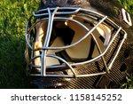 a goalie black helmet for ice... | Shutterstock . vector #1158145252