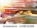 man is baking bread in the oven | Shutterstock . vector #1158216208
