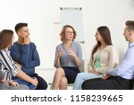 people at group psychotherapy... | Shutterstock . vector #1158239665