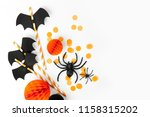 Stock photo halloween holiday decorations striped straws with paper bats and confetti spiders on white 1158315202