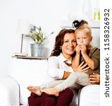 happy smiling mother with... | Shutterstock . vector #1158326932