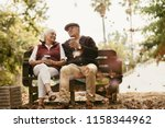relaxed senior couple on picnic ... | Shutterstock . vector #1158344962
