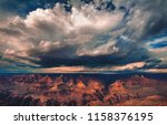 A thunderstorm builds and releases rain over the south rim of the Grand Canyon National Park in Arizona, USA. - stock photo