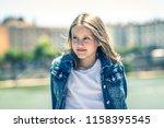 outdoor portrait of young girl... | Shutterstock . vector #1158395545