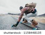 skater traveling iceland on his ... | Shutterstock . vector #1158448135