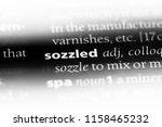 Small photo of sozzled word in a dictionary. sozzled concept.