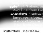 Small photo of solecism word in a dictionary. solecism concept.