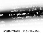 Small photo of scrupulous word in a dictionary. scrupulous concept.