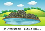 pond in a park with rock... | Shutterstock .eps vector #1158548632