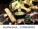 gourmet swiss fondue dinner on... | Shutterstock . vector #1158636352