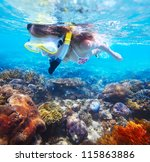 young woman snorkeling over... | Shutterstock . vector #115863886