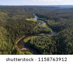 Aerial view of vast boreal aka taiga forest on sunny summer day in Oulanka National Park, Finland