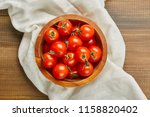 fresh red cherry tomatoes in... | Shutterstock . vector #1158820402