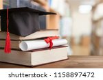 graduation hat on stack of books | Shutterstock . vector #1158897472