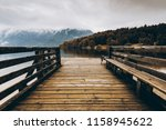 wooden pier at autumn lake ... | Shutterstock . vector #1158945622