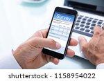 close up of a businessman's... | Shutterstock . vector #1158954022