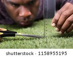 Close Up Of A Man Cutting Gree...
