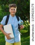 cute  young schoolboy in blue... | Shutterstock . vector #1159023175