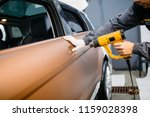 car wrapping specialist putting ... | Shutterstock . vector #1159028398
