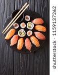 sushi rolls set served on black ... | Shutterstock . vector #1159137262