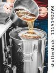 faceless shot of man pouring... | Shutterstock . vector #1159140298