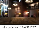 empty dark wooden table in... | Shutterstock . vector #1159153912