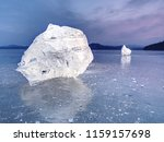 ice piece in blue shadows  on... | Shutterstock . vector #1159157698