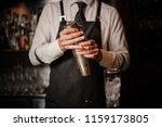 professional bartender holding... | Shutterstock . vector #1159173805