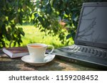 cup of coffee  a computer on a... | Shutterstock . vector #1159208452