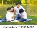 asian family enjoyed outdoor... | Shutterstock . vector #1159216702