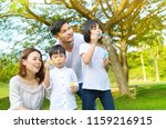 asian family blowing bubbles in ... | Shutterstock . vector #1159216915