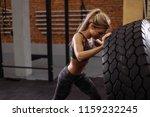 beautiful female bodybuilder is ... | Shutterstock . vector #1159232245