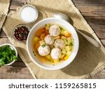 soup with meatballs in white... | Shutterstock . vector #1159265815