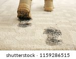 person in dirty shoes leaving... | Shutterstock . vector #1159286515