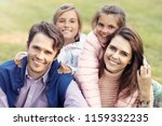 young family with children... | Shutterstock . vector #1159332235