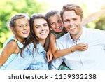 young family with children... | Shutterstock . vector #1159332238