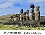 Row of Moai Statues on Ahu against Blue Sky on Easter Island, Chile, South America