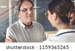 health worker talking to the... | Shutterstock . vector #1159365265