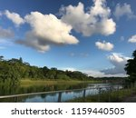 reflection in river waterway ... | Shutterstock . vector #1159440505