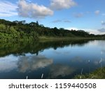 reflection in river waterway ... | Shutterstock . vector #1159440508