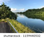 reflection in river waterway ... | Shutterstock . vector #1159440532