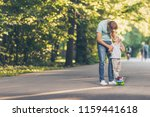smiling father and son with a... | Shutterstock . vector #1159441618