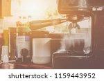 Small photo of Preparing for coffee by coffee machine Smoke has risen.